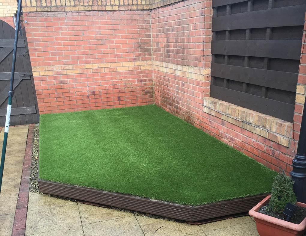 York artificial grass over decking after polished for Garden decking with artificial grass